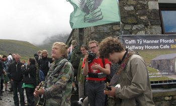 Mike Peters playing guitar on Mt. Snowdon
