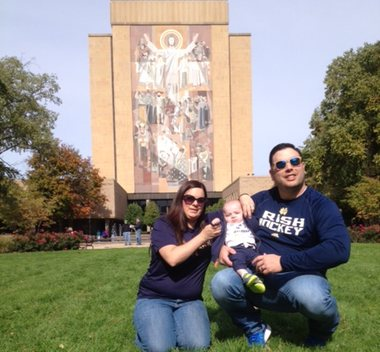 Rocco and his family in from of Touchdown Jesus